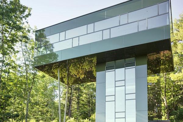 Image of An Amazing Glass House That Peeks Over the Forest